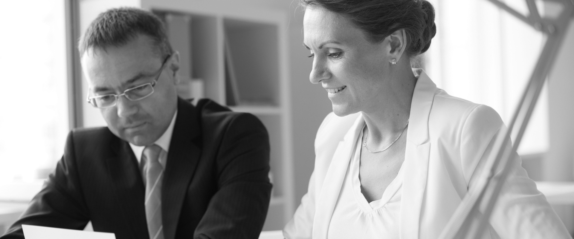a businesswoman talking with a businessman